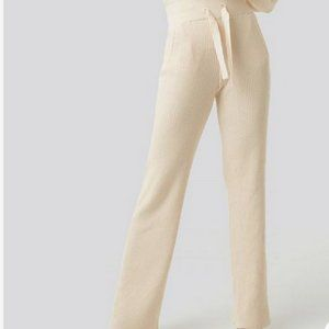 Sweater style cream pant stretch band top